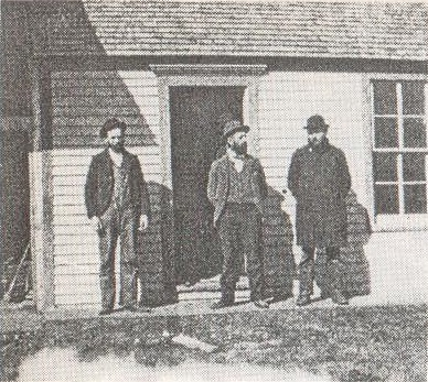 "A TRIO OF men stop to ""chew the fat"" over the day's news in front of the Frank Balzer Lumber Yard in 1888."